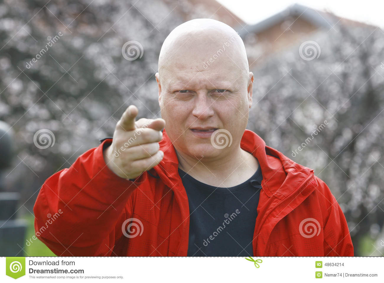 Man In A Red Jacket Threatening With Finger And Alerts