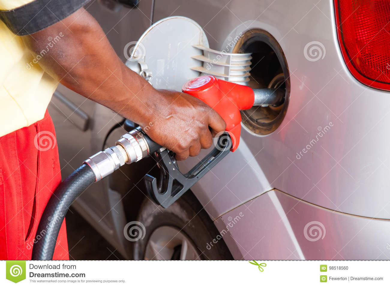 Man refuelling car with petrol or diesel at the petrol station