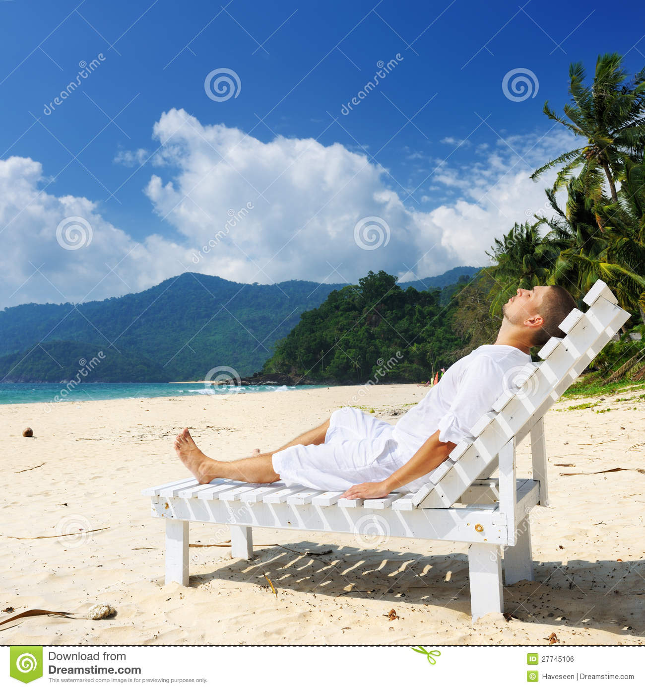 Man Relaxing On A Beach Stock Photo. Image Of Chaiselounge