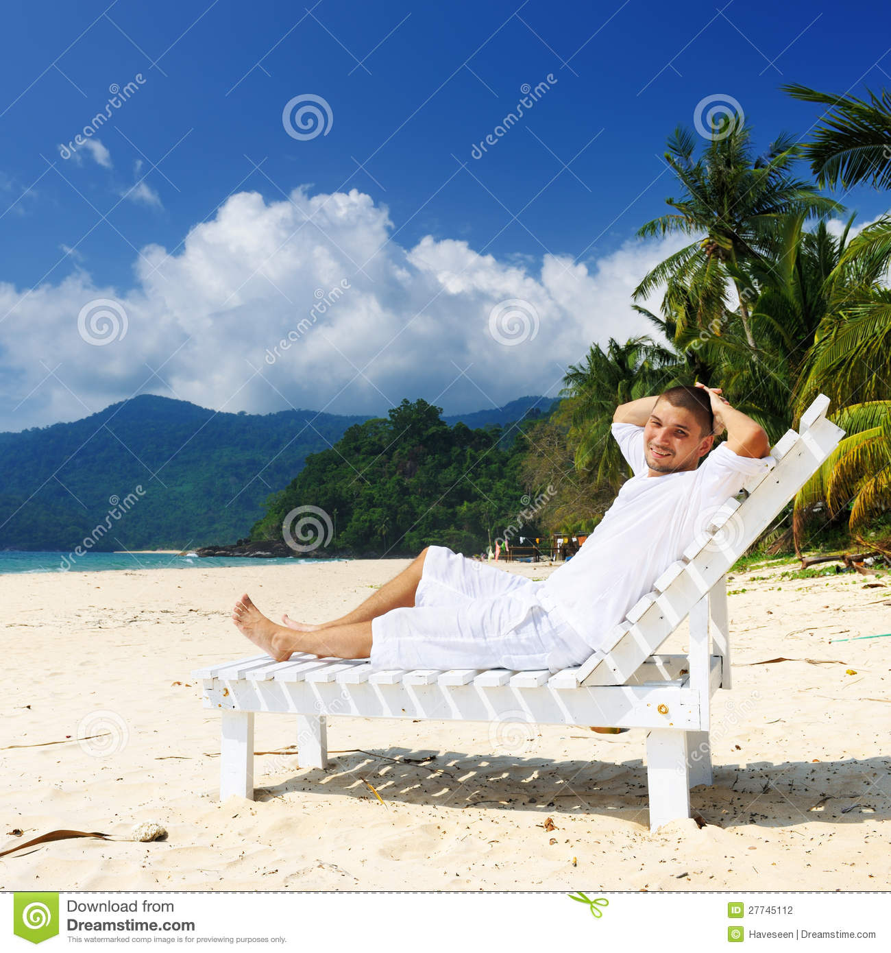 Man Relaxing On A Beach Stock Photo. Image Of Blue
