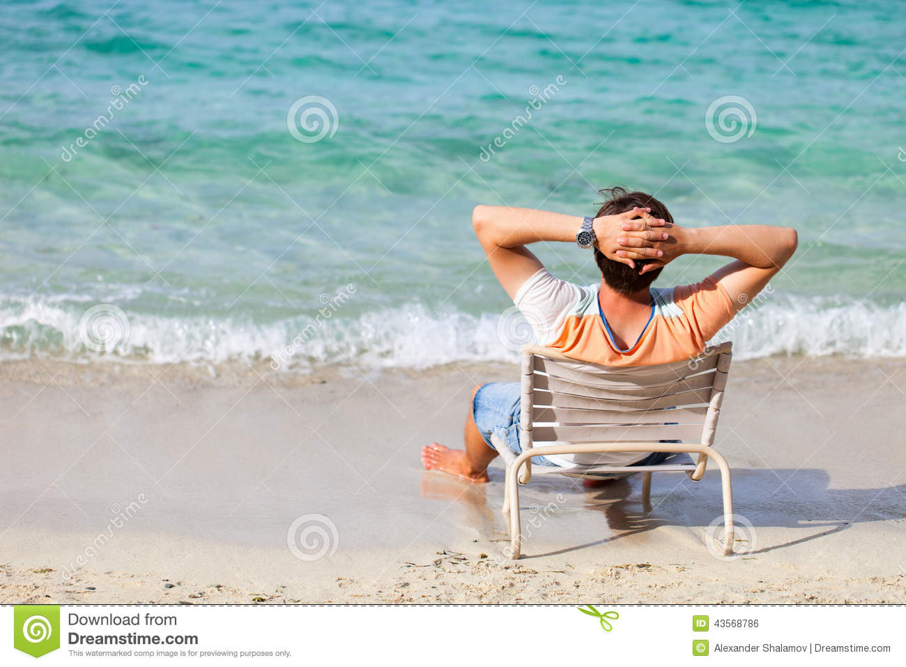 Man Relaxing At Beach Stock Photo 43568786