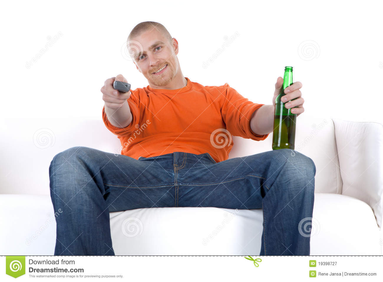 Man Relaxing With Beer On Sofa Royalty Free Stock