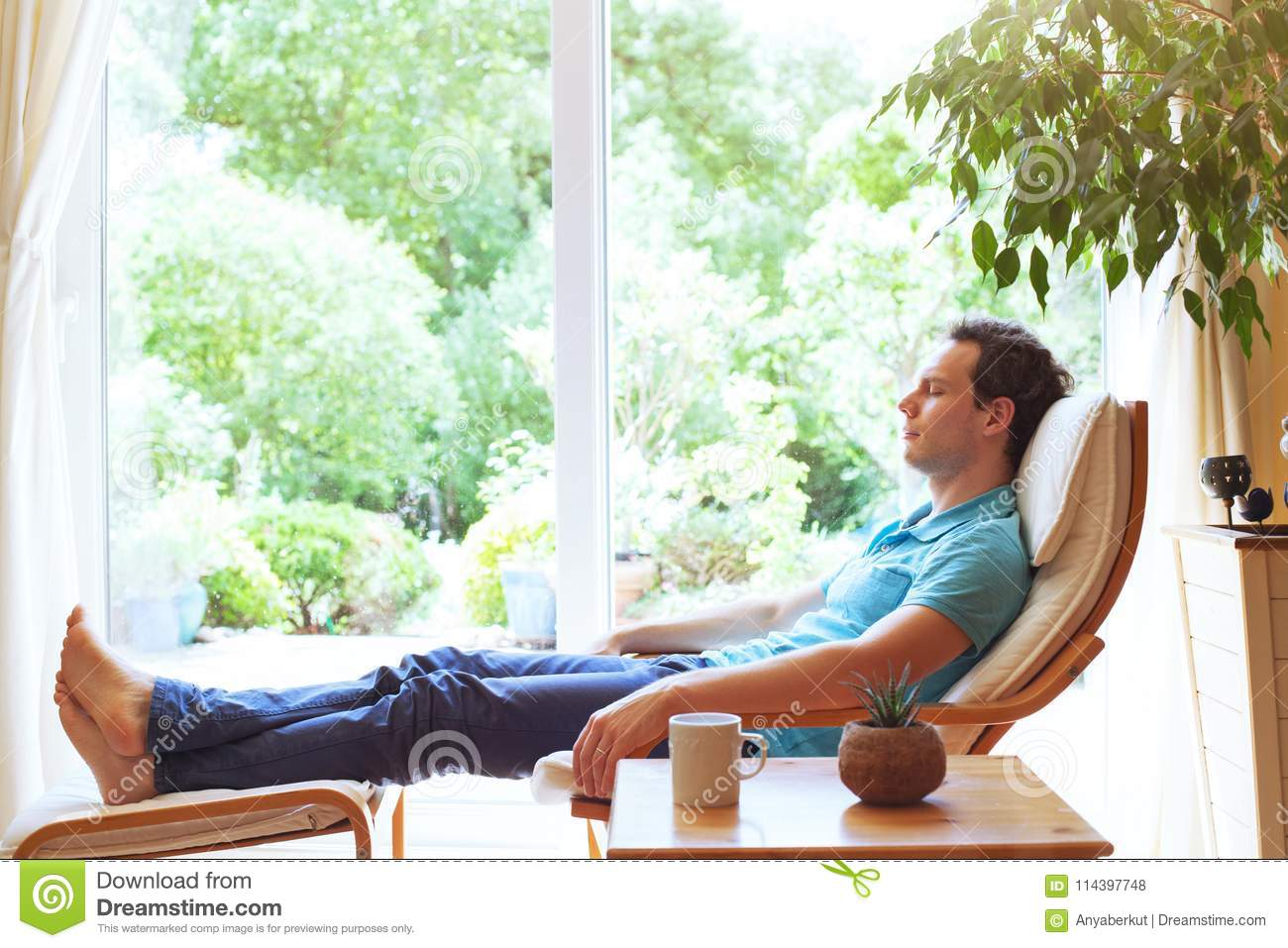 Man relaxing in deck chair at home, relaxation