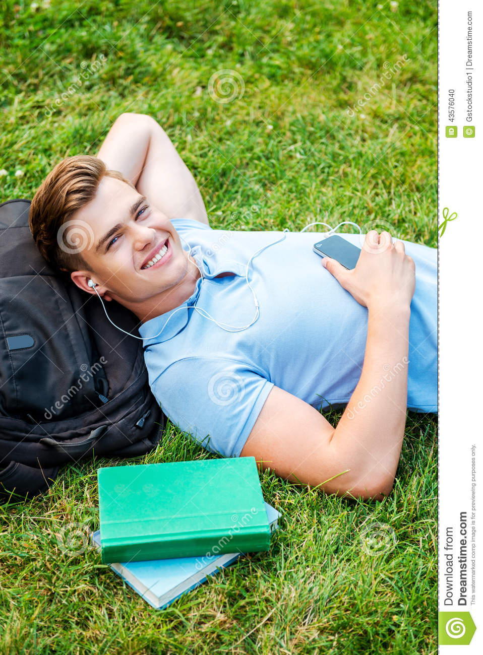 Teenager Relaxing With Hands Behind Head Royalty-Free ...  Teenager Relaxi...