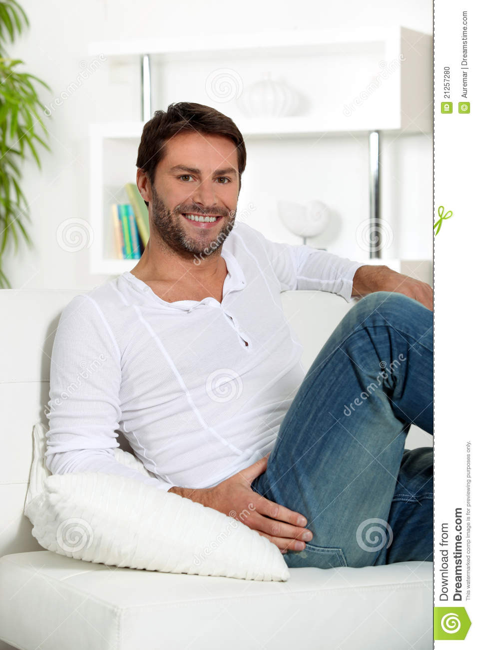 man relaxing at home stock photo image 21257280. Black Bedroom Furniture Sets. Home Design Ideas