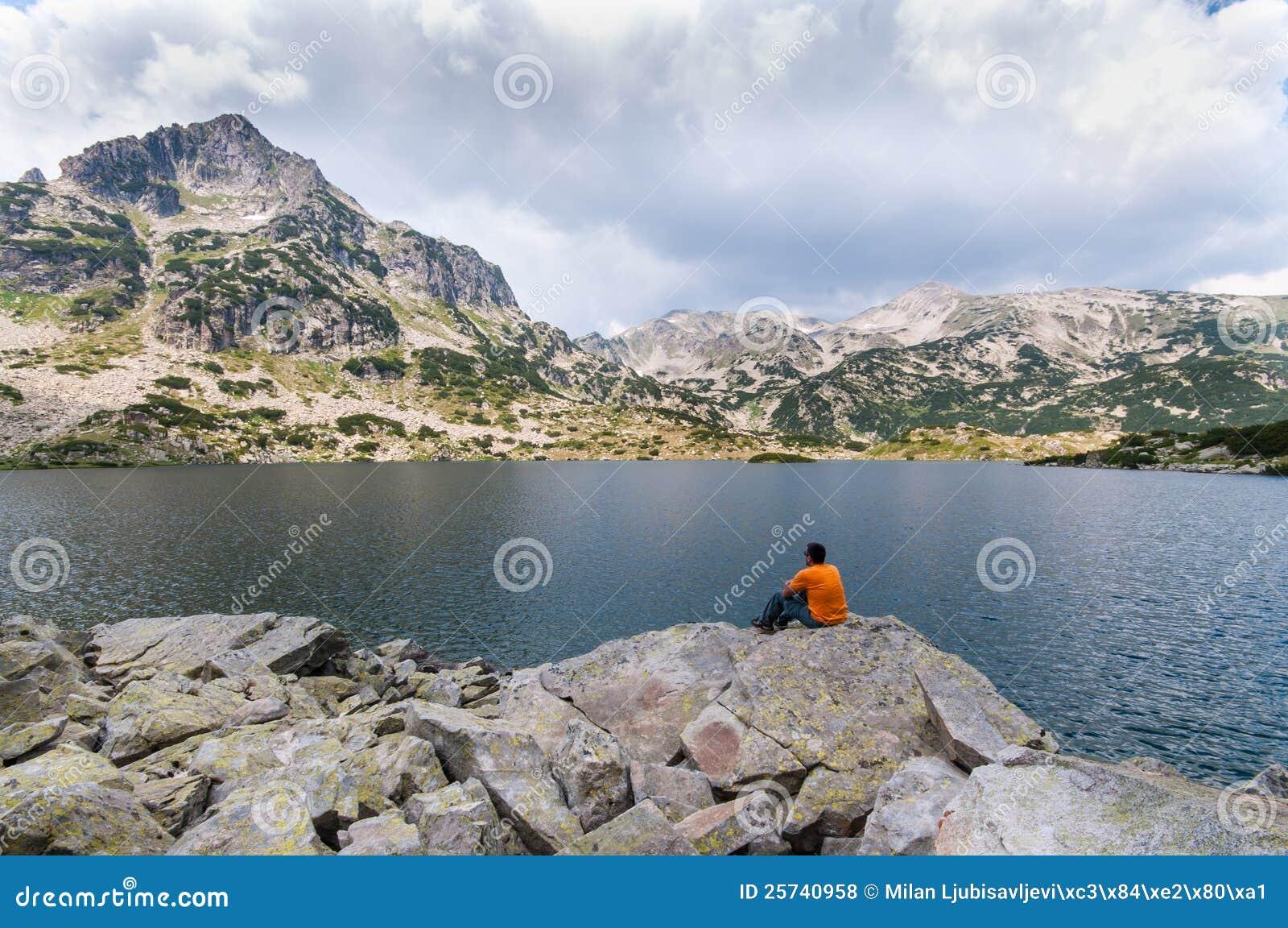 Man Relaxing on Lake