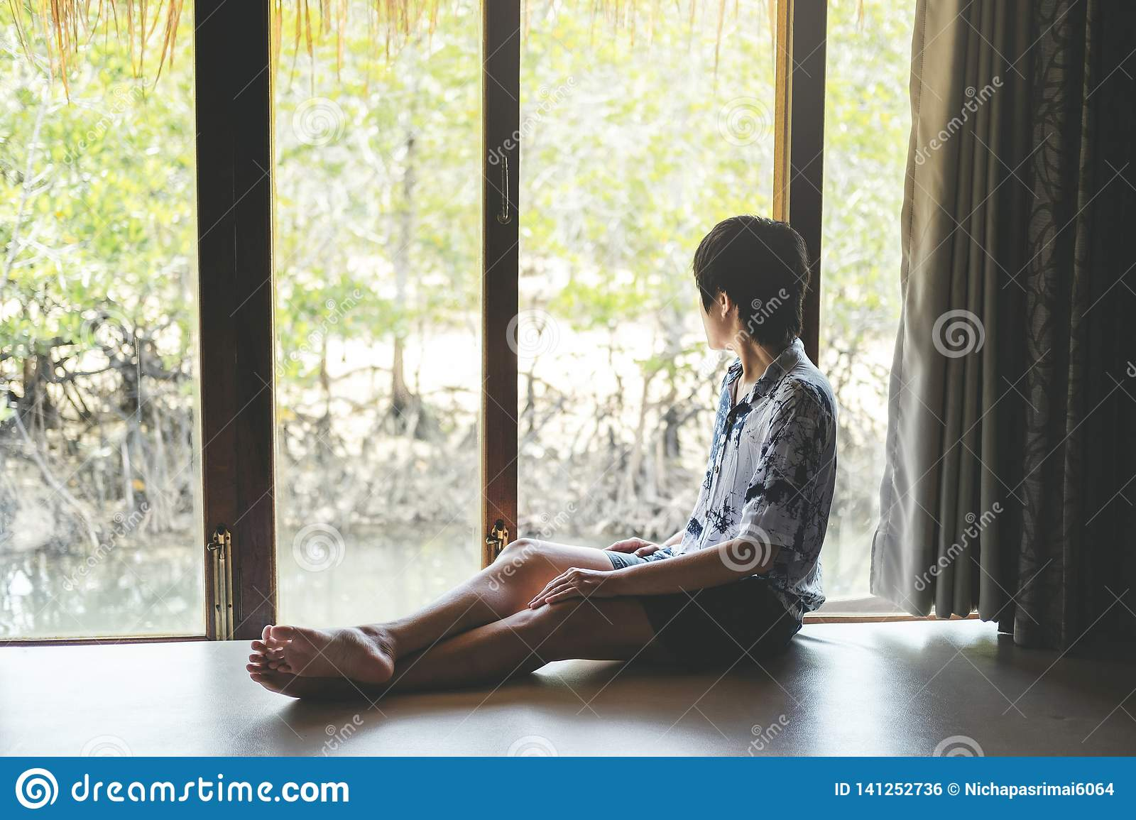 Man relaxing in mangrove forest Lagoon vacation time