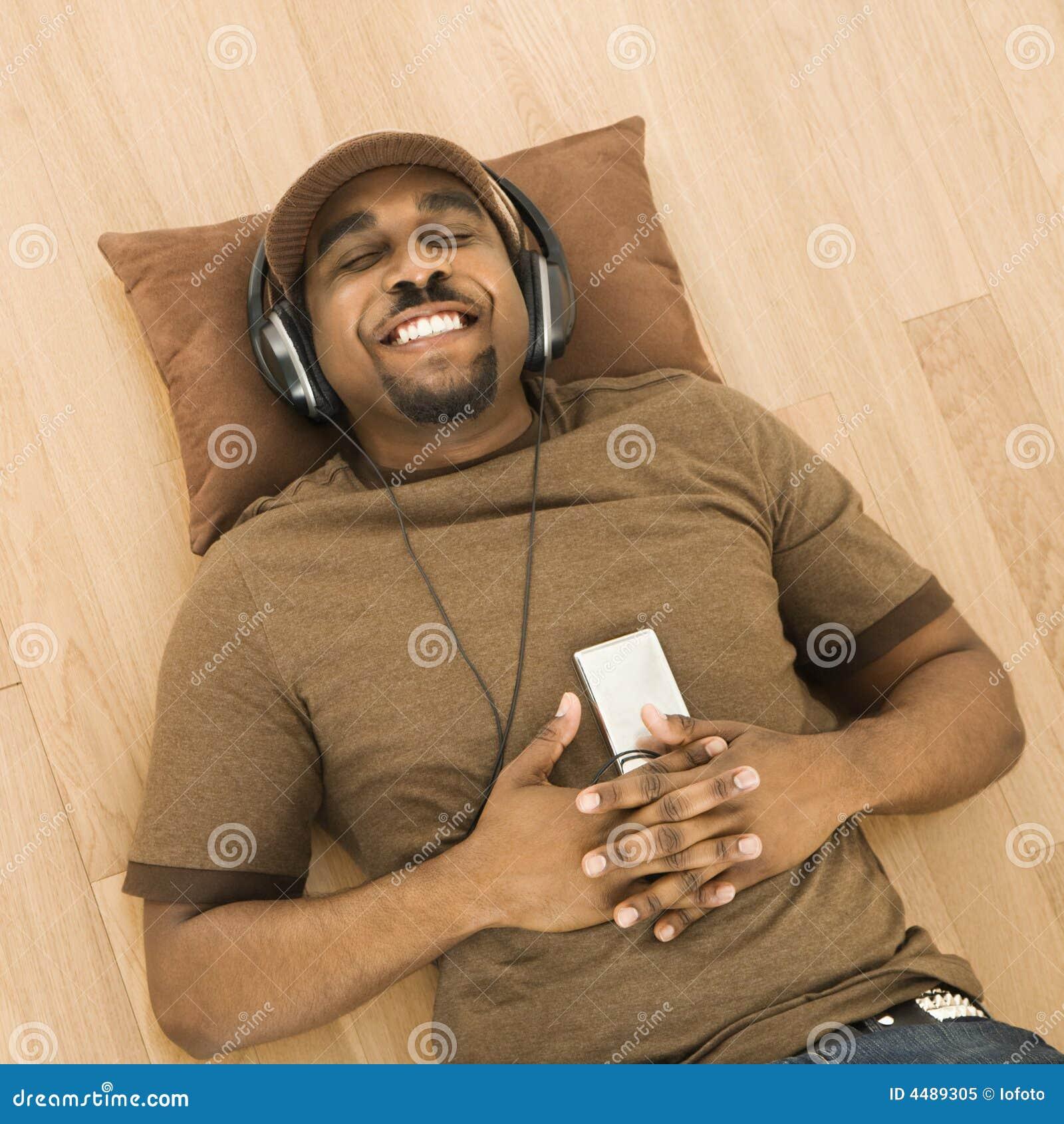Man relaxing to music.