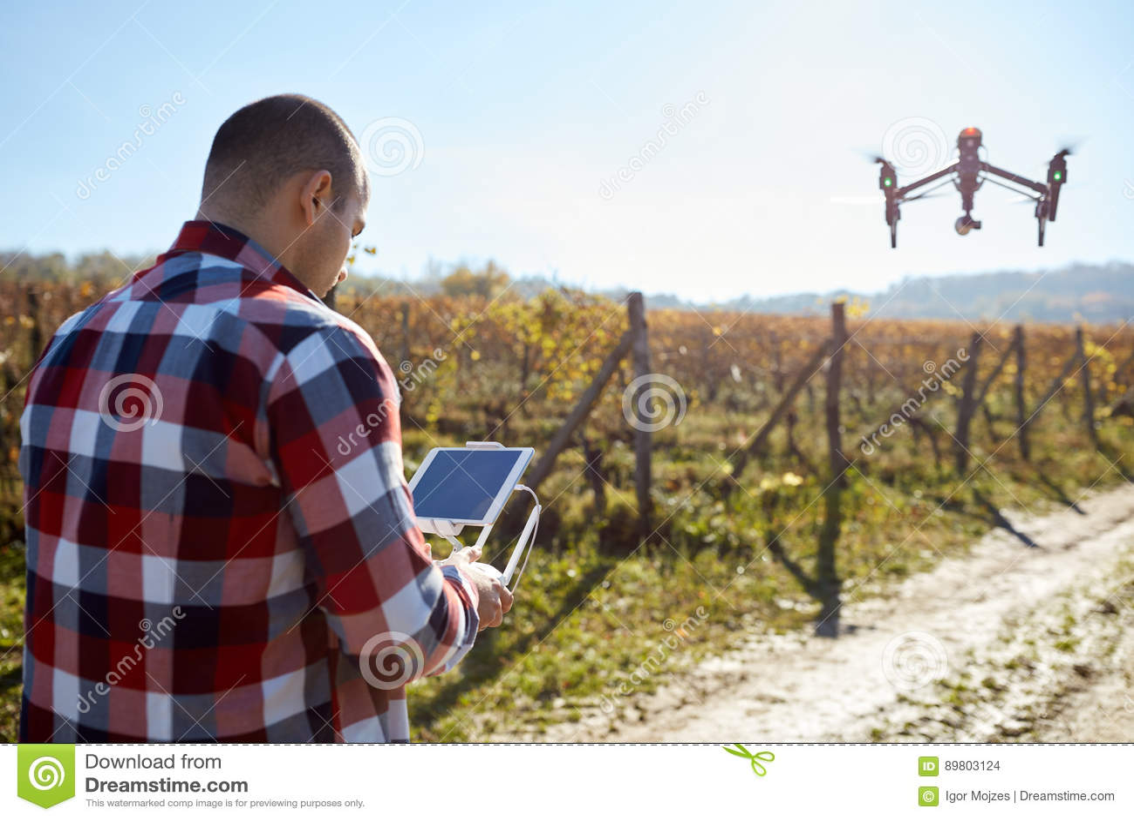 Man remote control flying drone