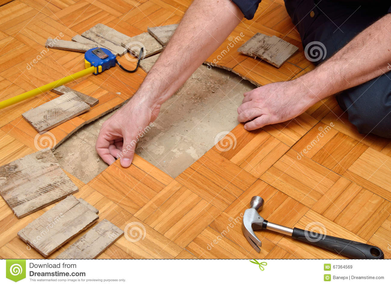 man removing damaged parquet stock photo image 67364569. Black Bedroom Furniture Sets. Home Design Ideas