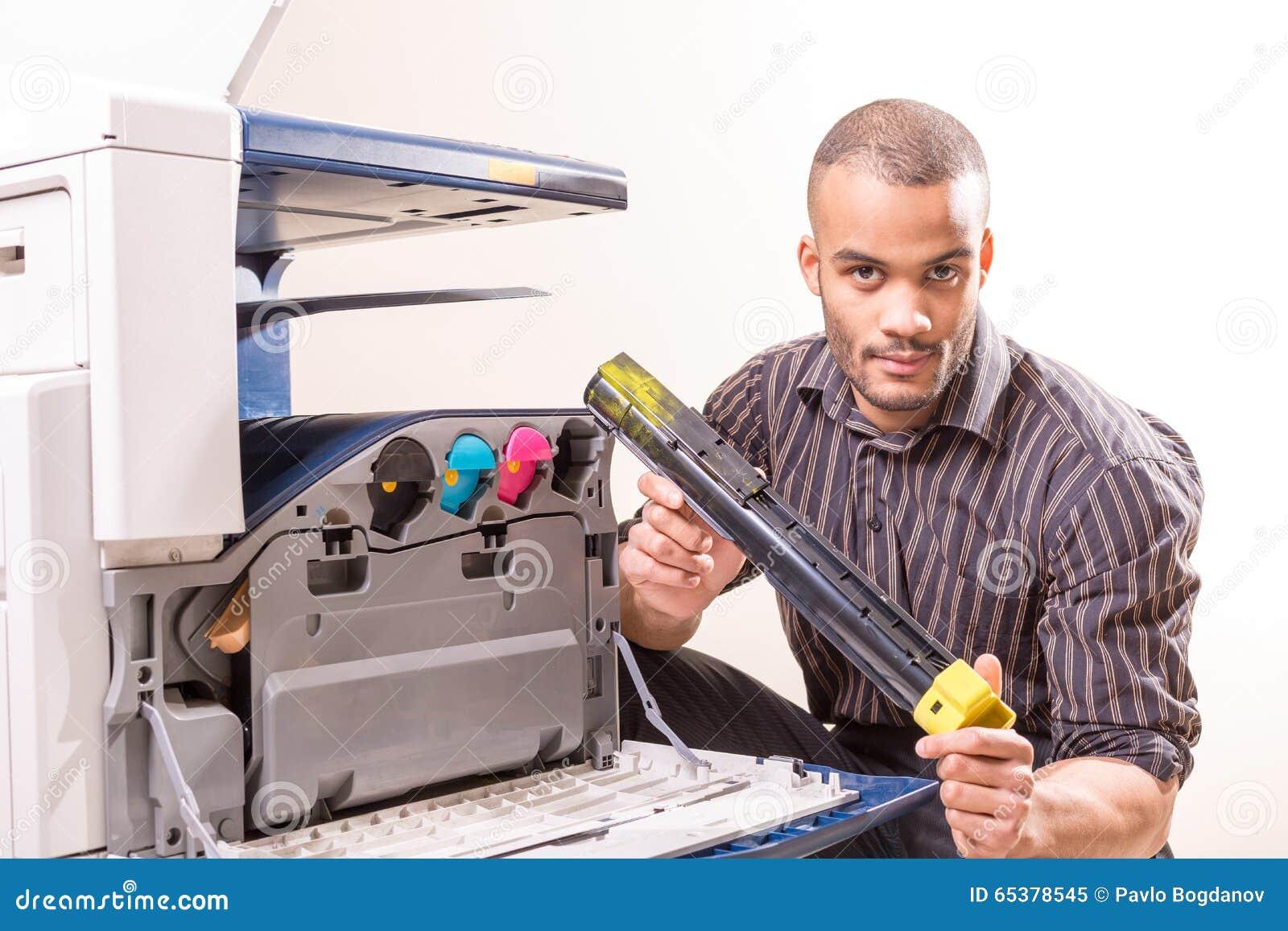 man repairing color printer changing toner cartridge stock