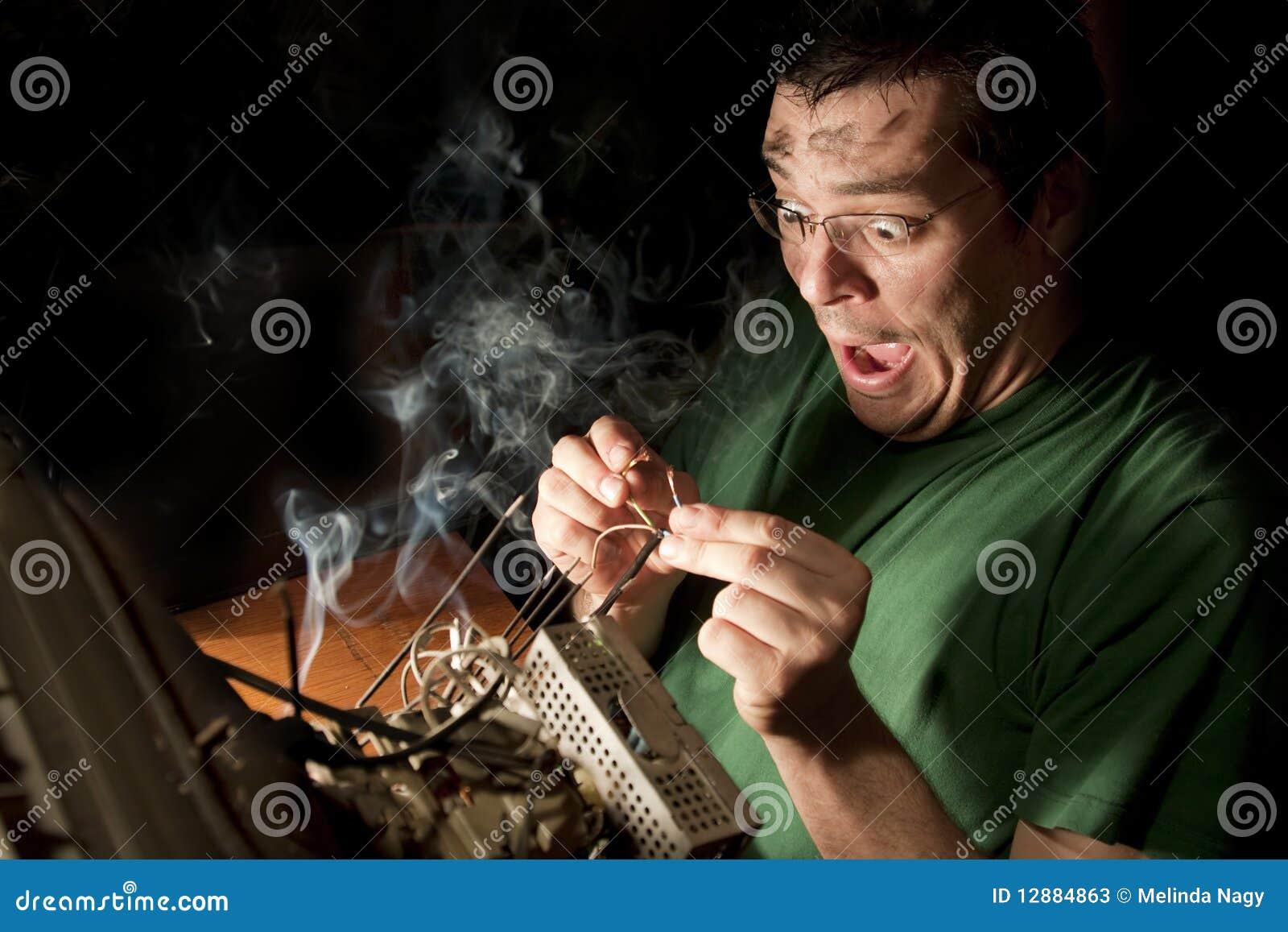 Man Repairing Computer On Fire Stock Photos - Image: 12884863
