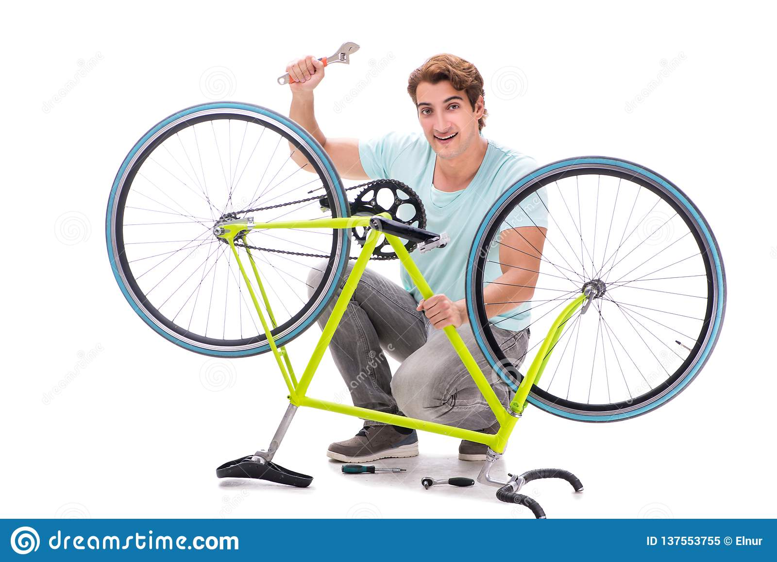 The man repairing his bike isolated on white background