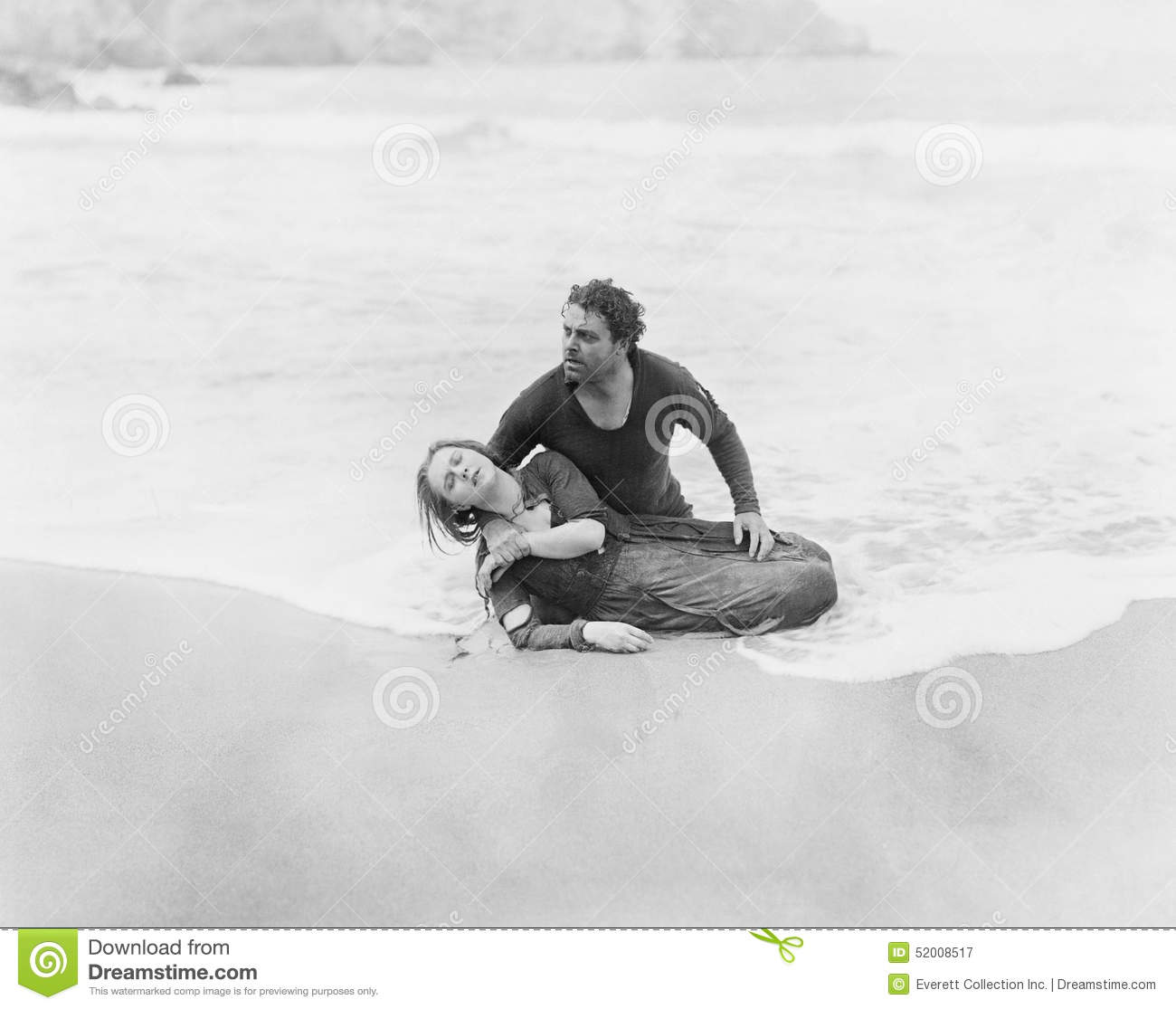 Man Rescuing Woman From Ocean Stock Photo