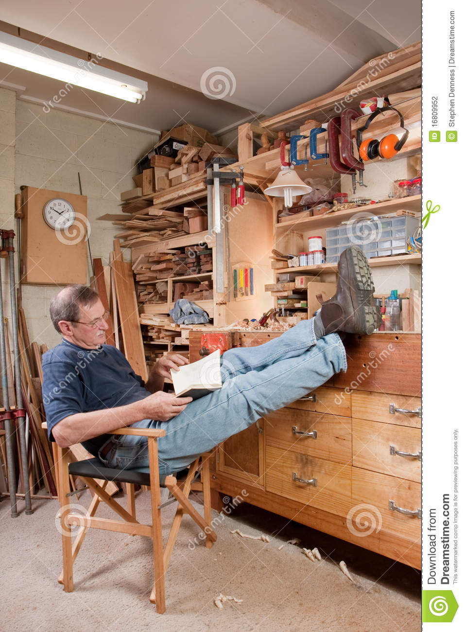 Man resting with feet up in workshop