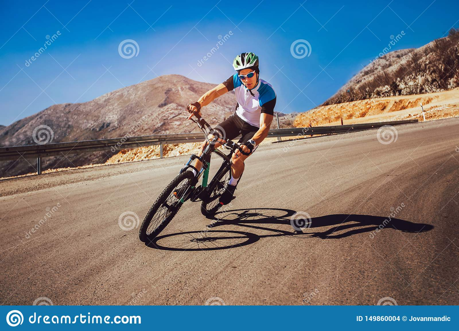 Man Ride Mountain Bike On The Road  Stock Photo - Image of