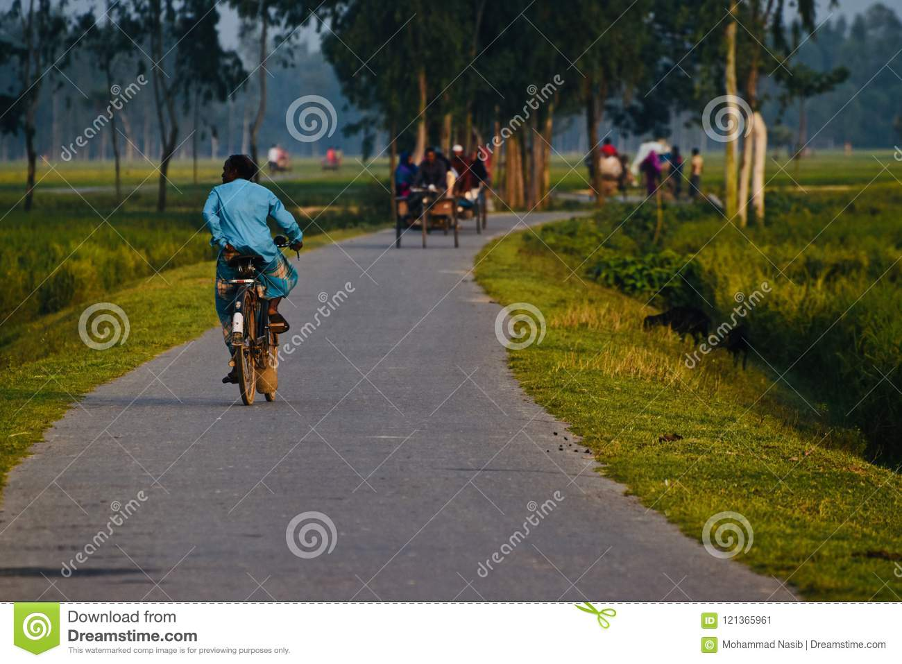 Download Man Riding On A Bicycle In A Village Road Isolated Unique Photo Editorial Photo - Image of free, colorful: 121365961