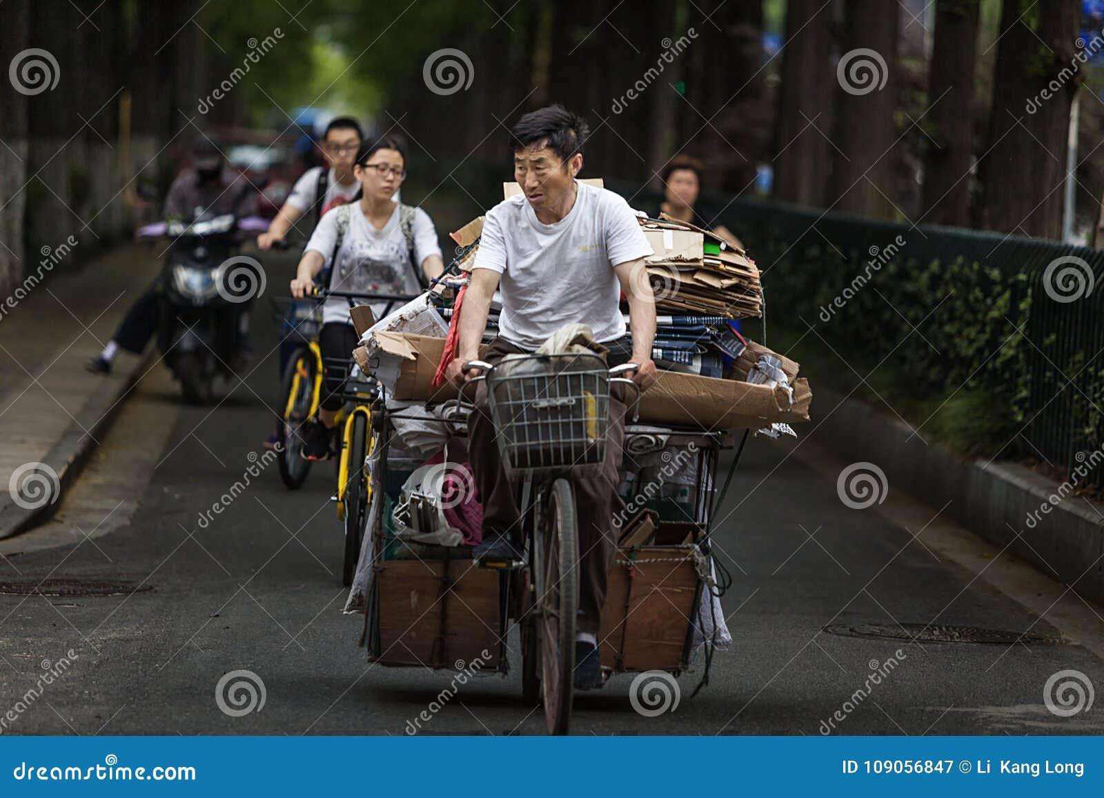 Man riding a bike to buy scrap