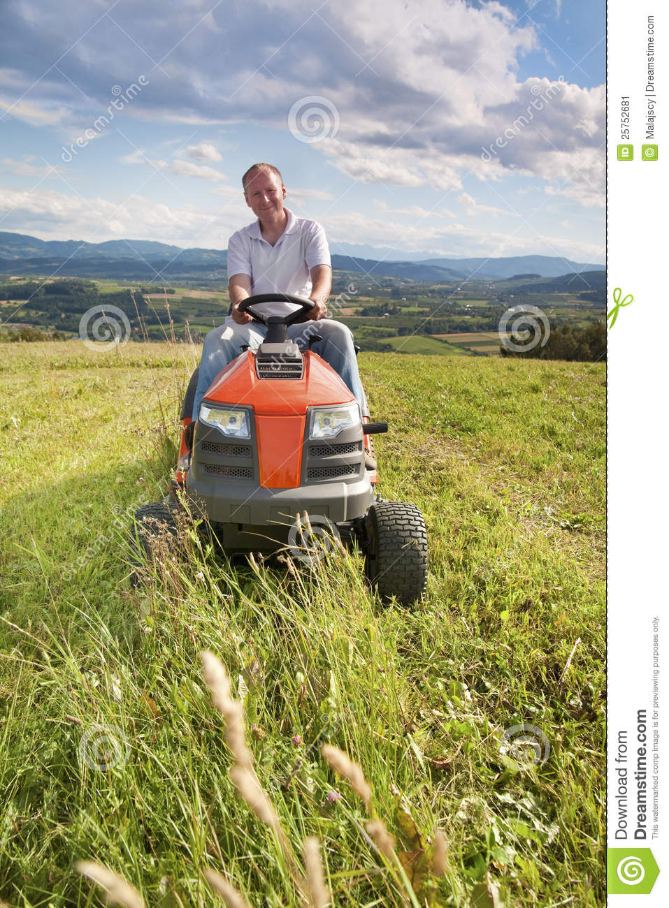 Man Riding Lawn Mower : Man riding a lawn tractor stock image