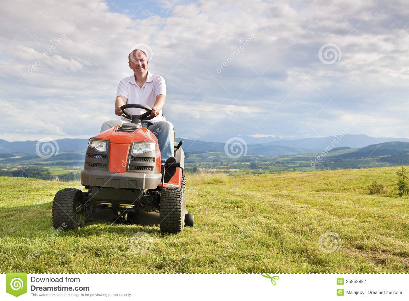 Man Riding Lawn Mower : Man riding a lawn tractor stock image of equipment