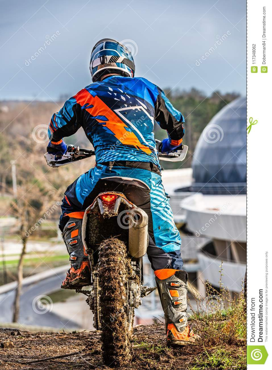 Dirty Motocross Racer Riding On Mud Stock Photo - Image of