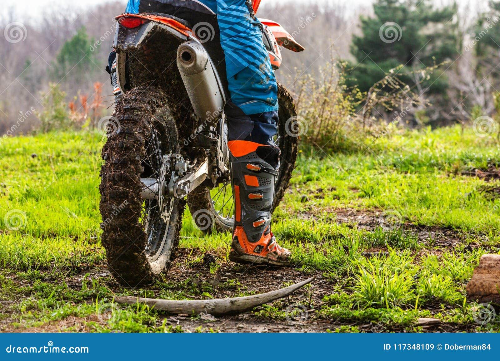 Dirt biker riding on path - Stock Image - F004/2262