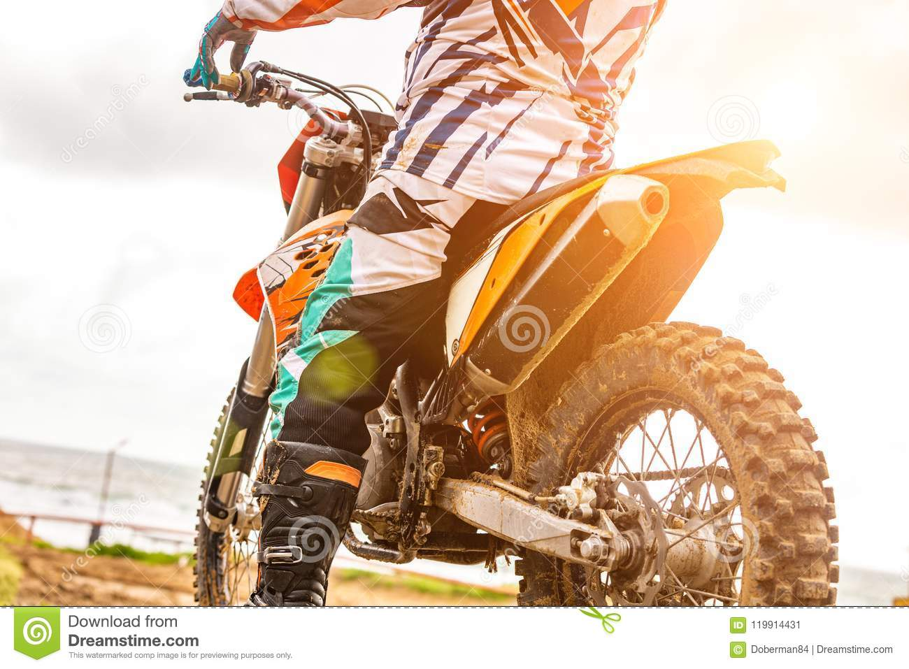 Motorcycle Rider In Mud Riding A Motocross Race High-Res
