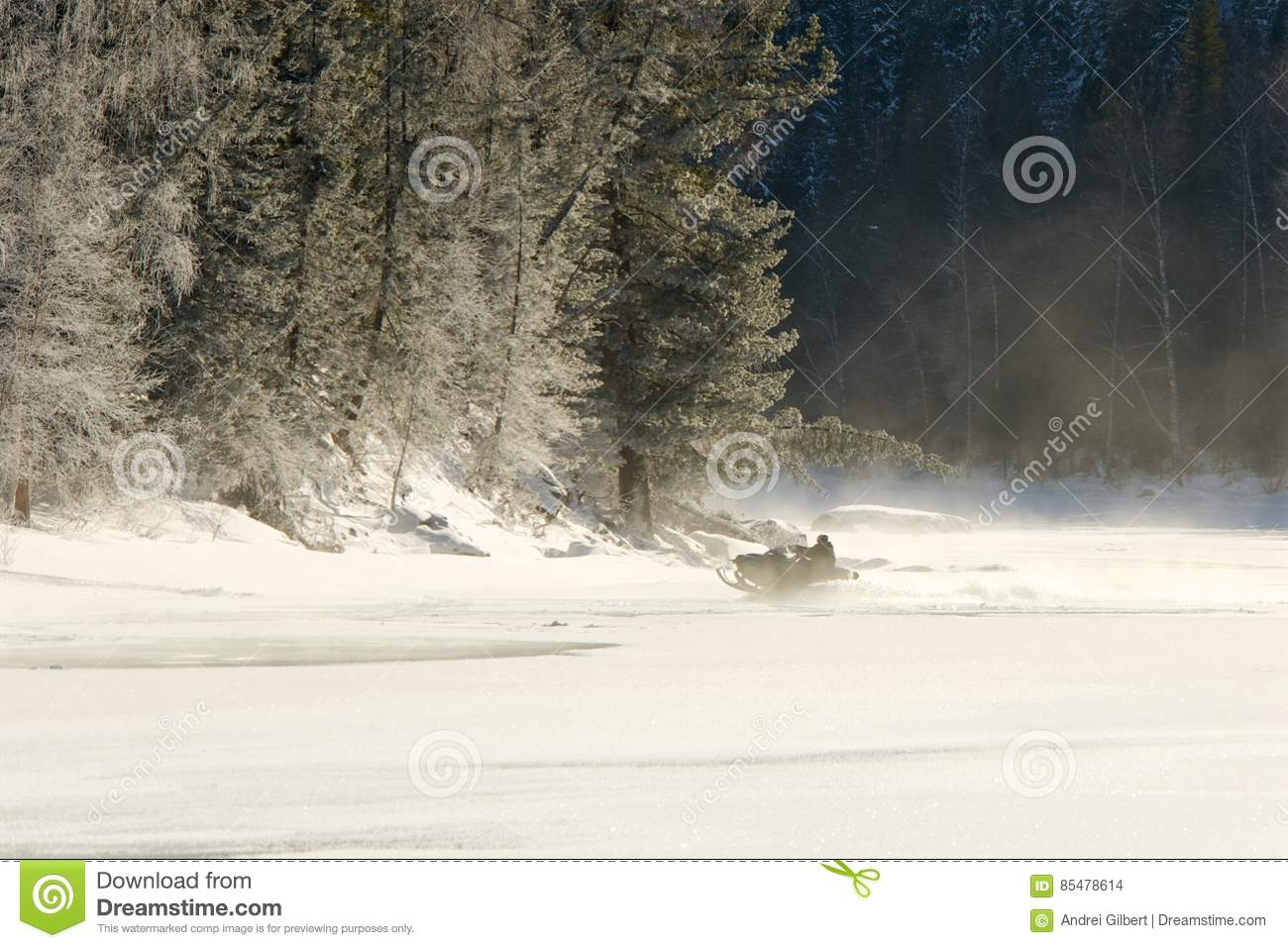 Man Riding On A Snowmobile Frozen Water Stock Photo