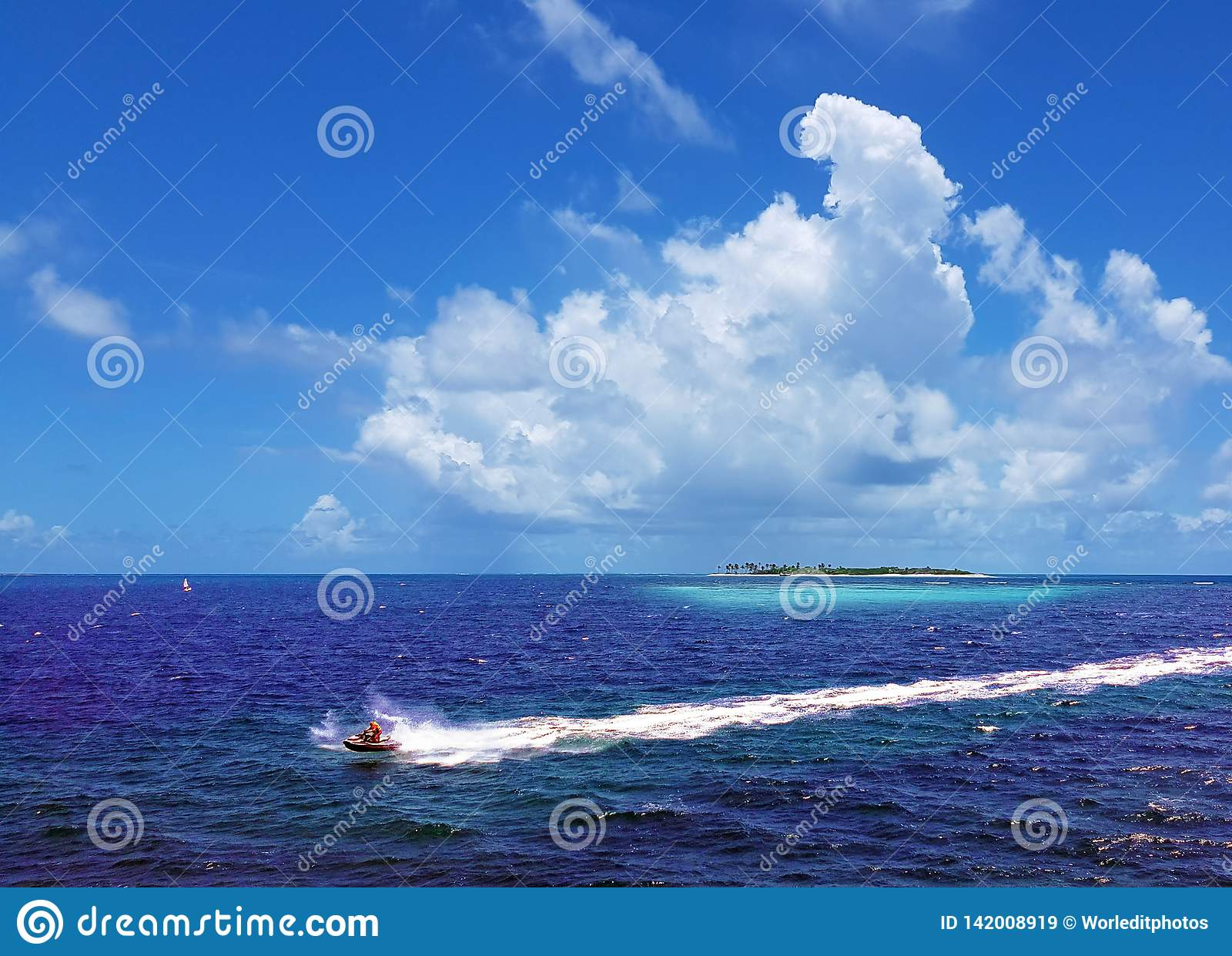A man is riding a water motorcycle on the blue sea. concept of sport, water recreation