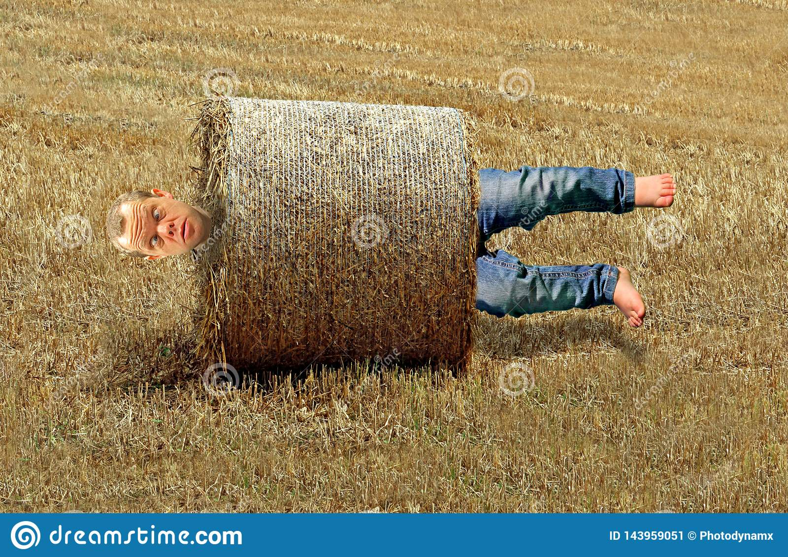 Man rolled up in farming hay bale accident stuck between a rock and a hard place