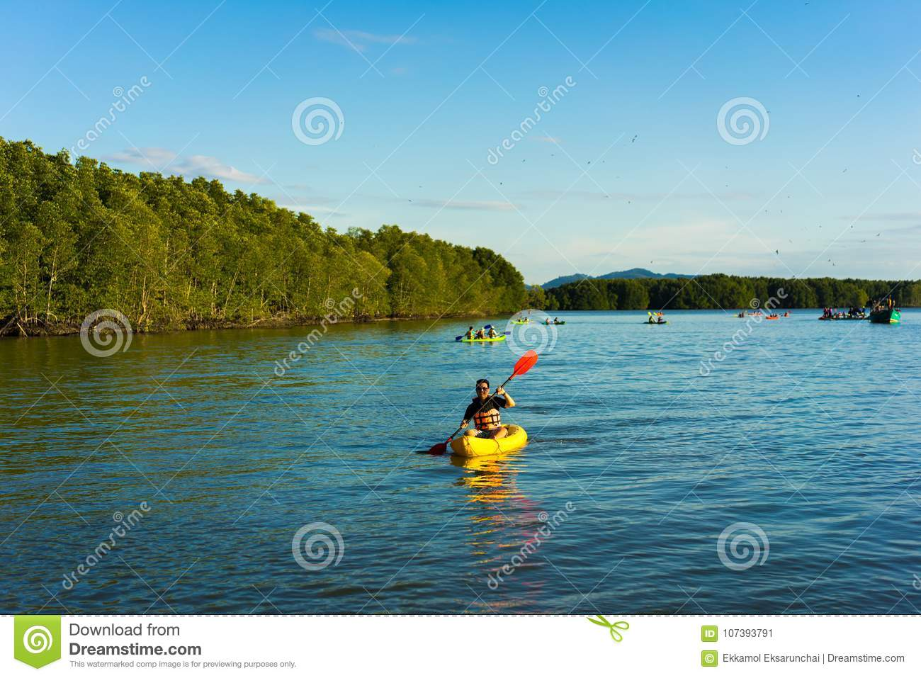A man are rowing kayak