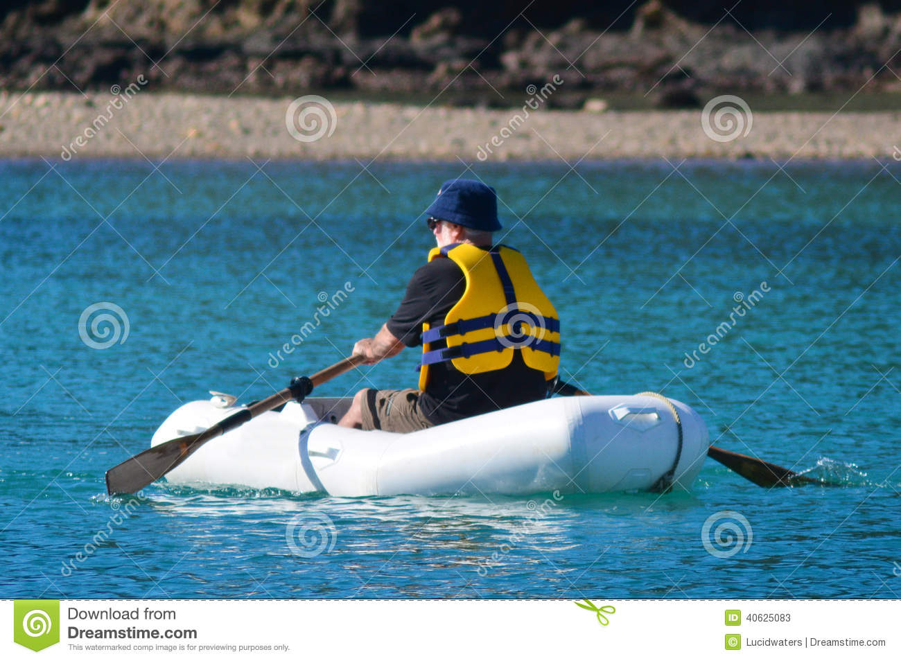 Man rows dinghy boat stock photo image 40625083 for Four man rubber life craft