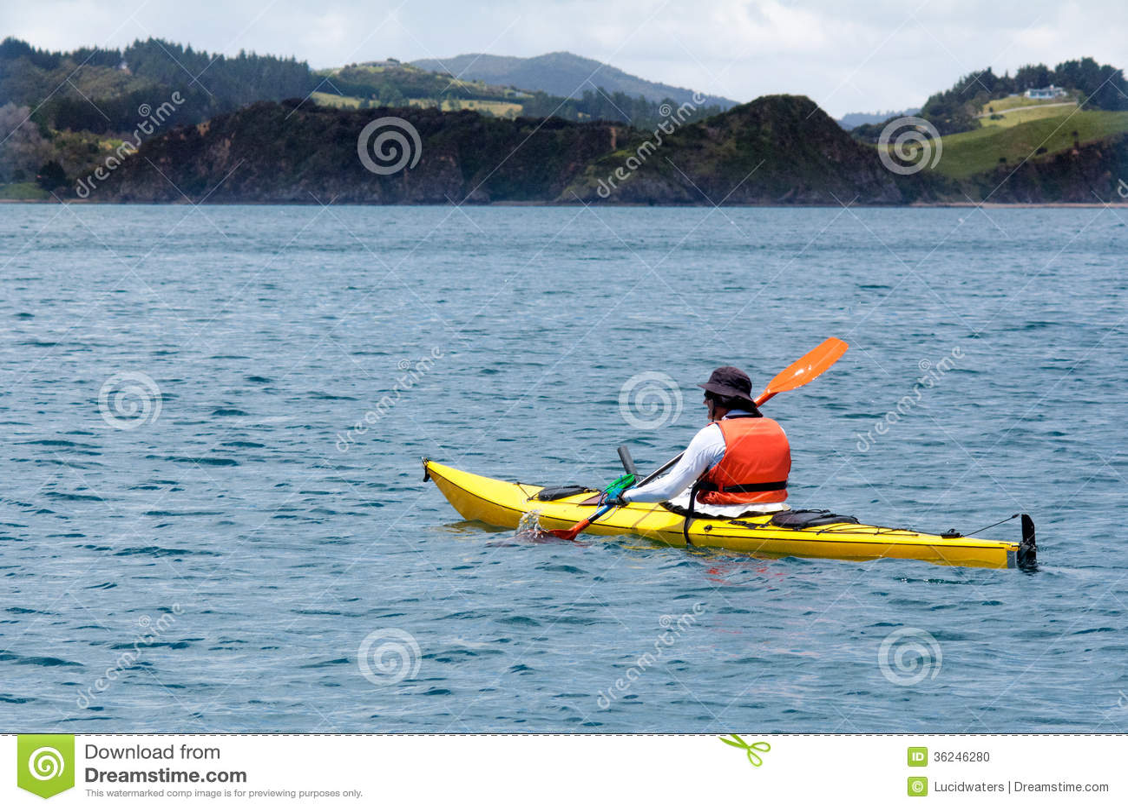 man rows a sea kayak stock photo image of coastline 36246280
