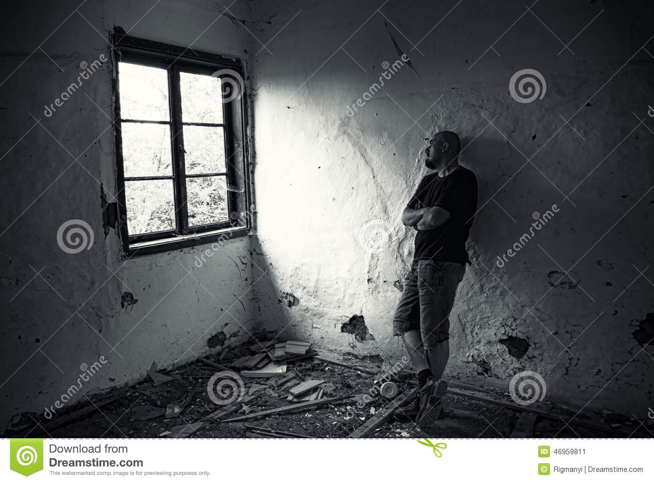 Home people men a sad young man walking home from work - Man In Ruined House Stock Image