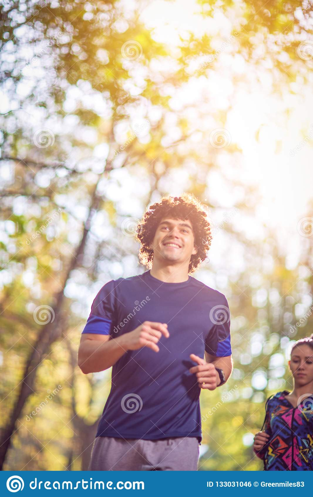Man running at the nature- fitness, sport, training and lifestyle concept.