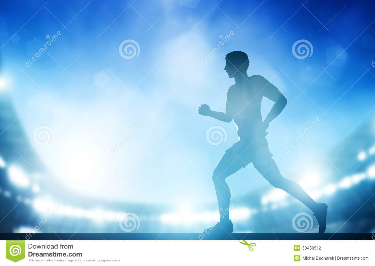 man running on the stadium in night lights  athletics run stock photo