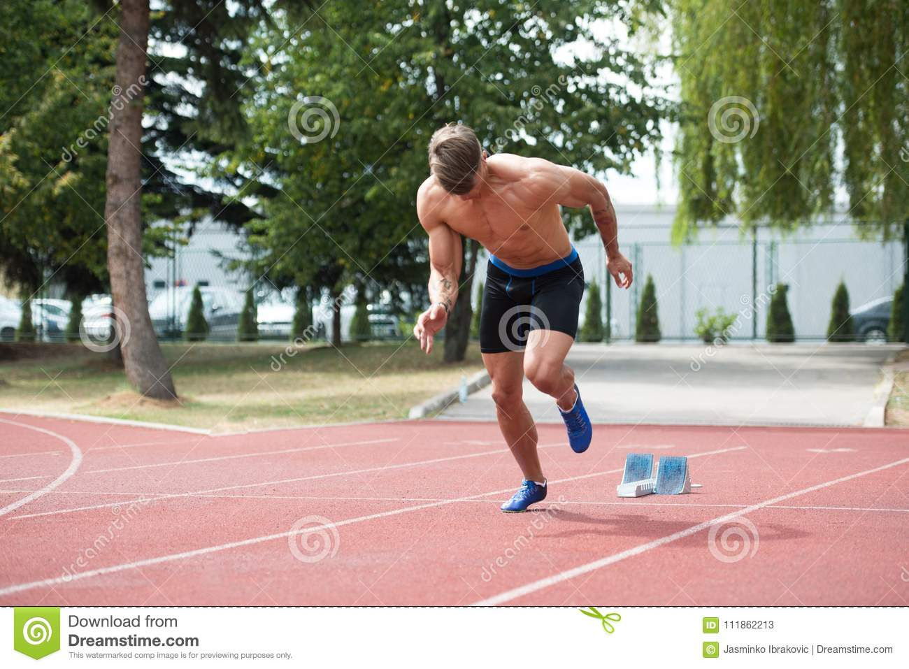 Man Running on Track stock image  Image of active, speed