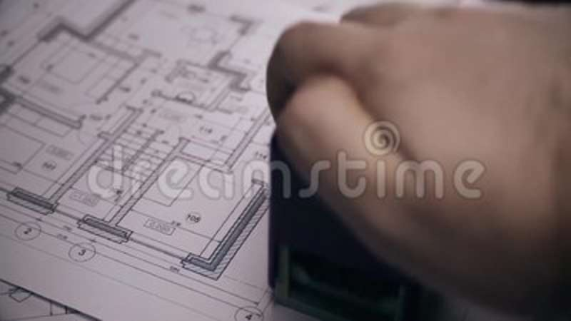 Mans arm puts print stamp on plan of house blurred blueprint of mans arm puts print stamp on plan of house blurred blueprint of house on background stock footage video of architecture estate 114577192 malvernweather Images