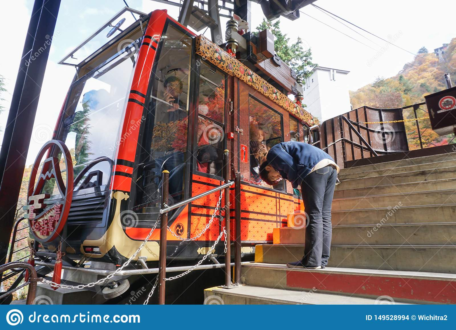 A man s bowing the traveler from the cable car after end of service at Lake Kawaguchi viewpoint,Japan