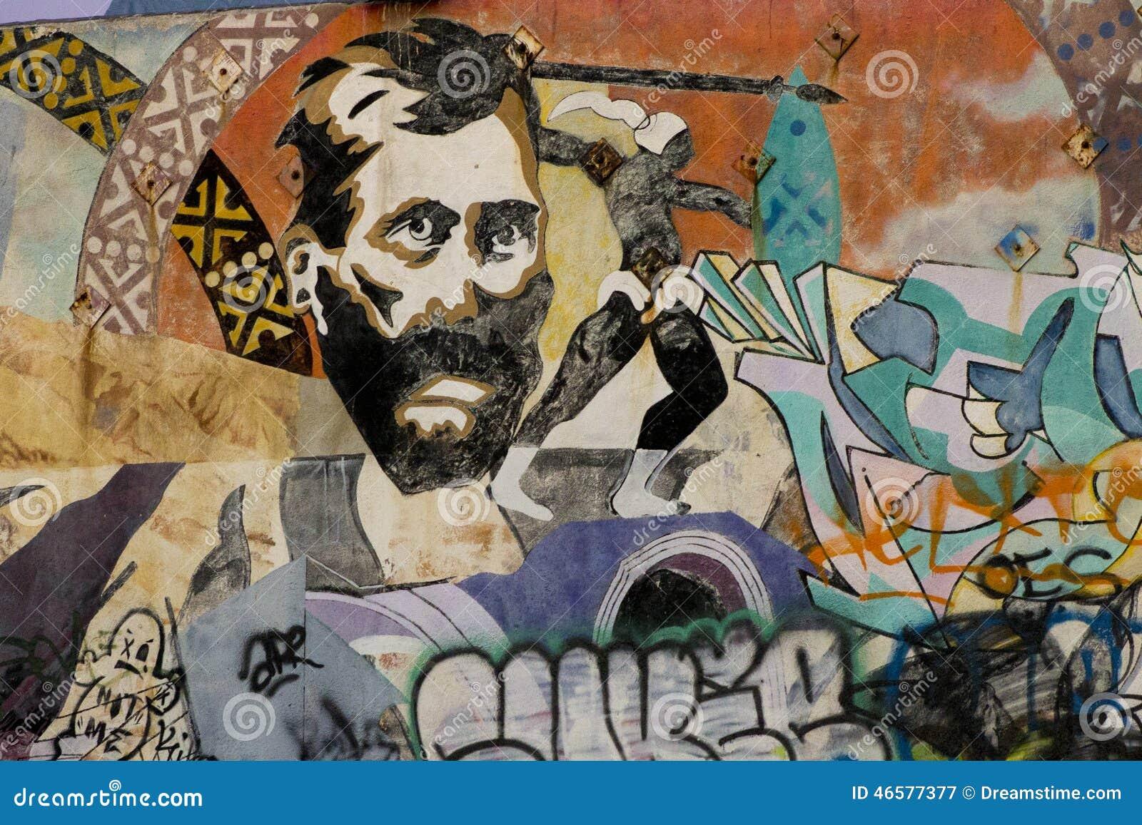 Grafitti wall painting - Man S Face Painted On Graffiti Wall Editorial Photography