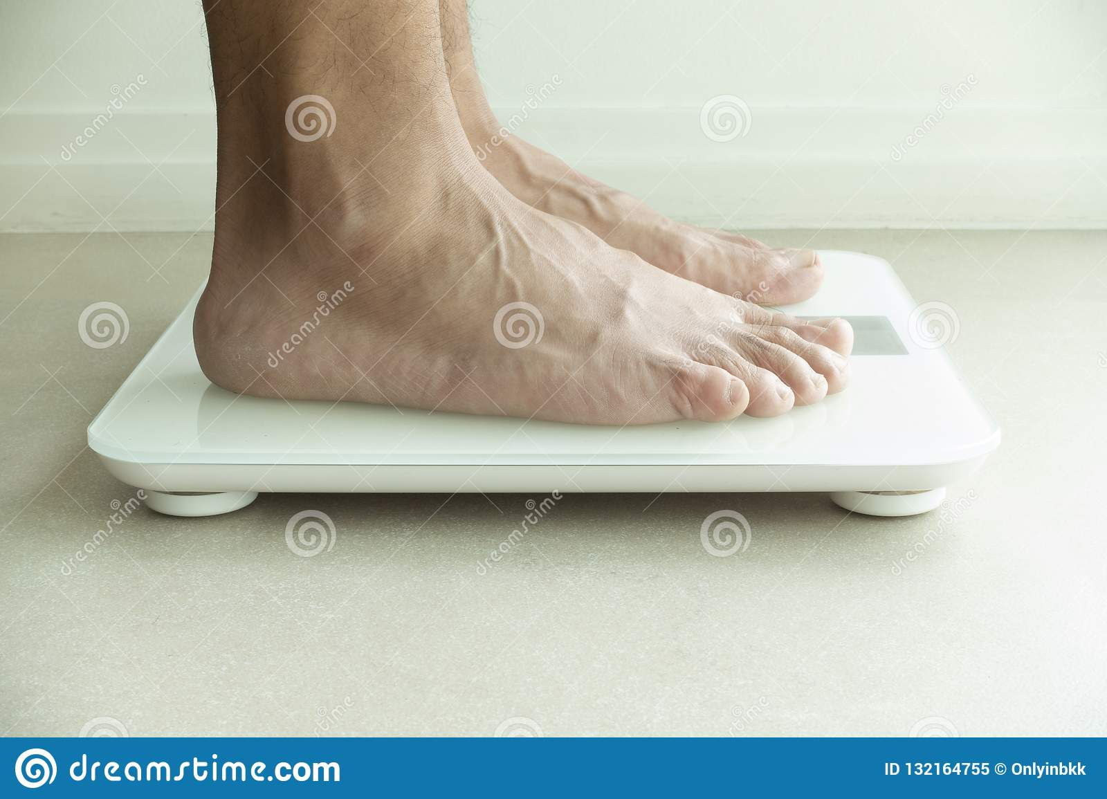Mans Feet On Weight Checking Machine