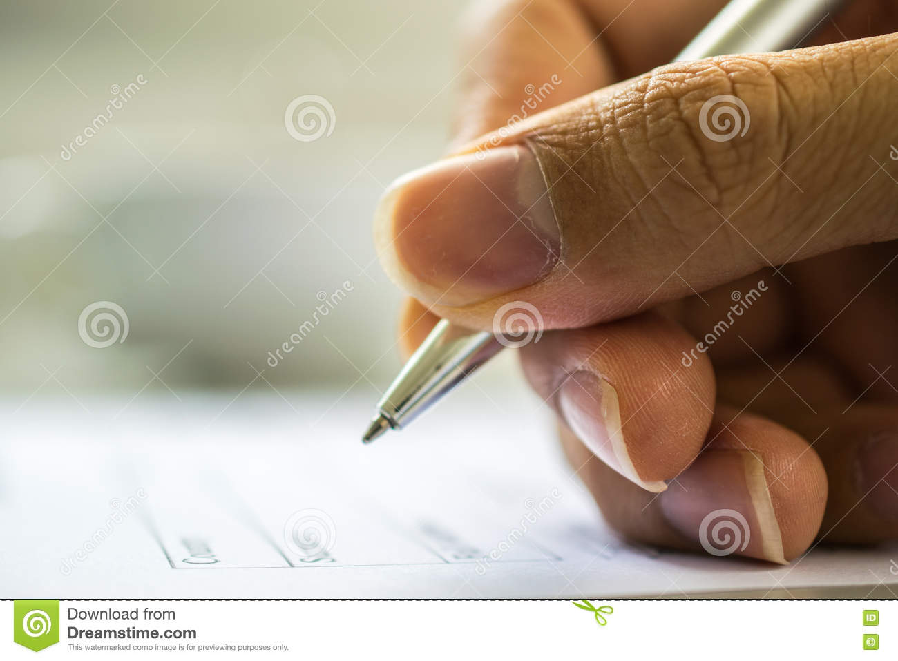man s hand filling application form stock photo image  man s hand filling application form