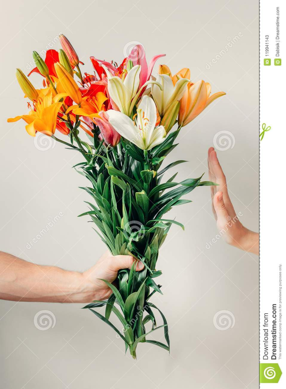Mans hand gives bouquet of lilies flowers to girl and receives mans hand gives bouquet of lilies flowers to girl and receives refusal izmirmasajfo