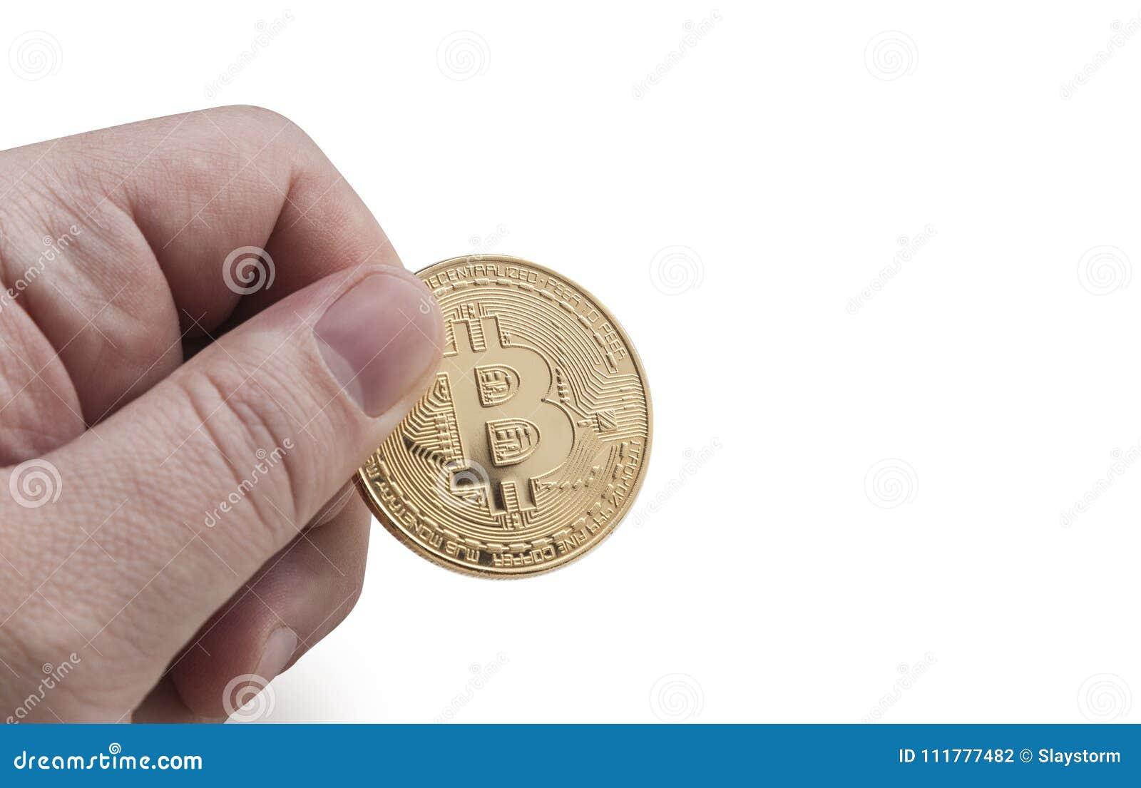 Man`s hand holding golden Bitcoin