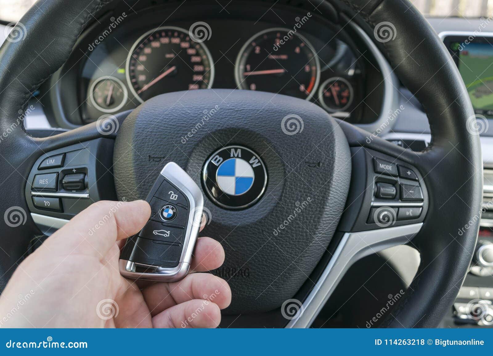 Man S Hand Holding A Wireless Bmw X5 F15 Car Key In Black Leather