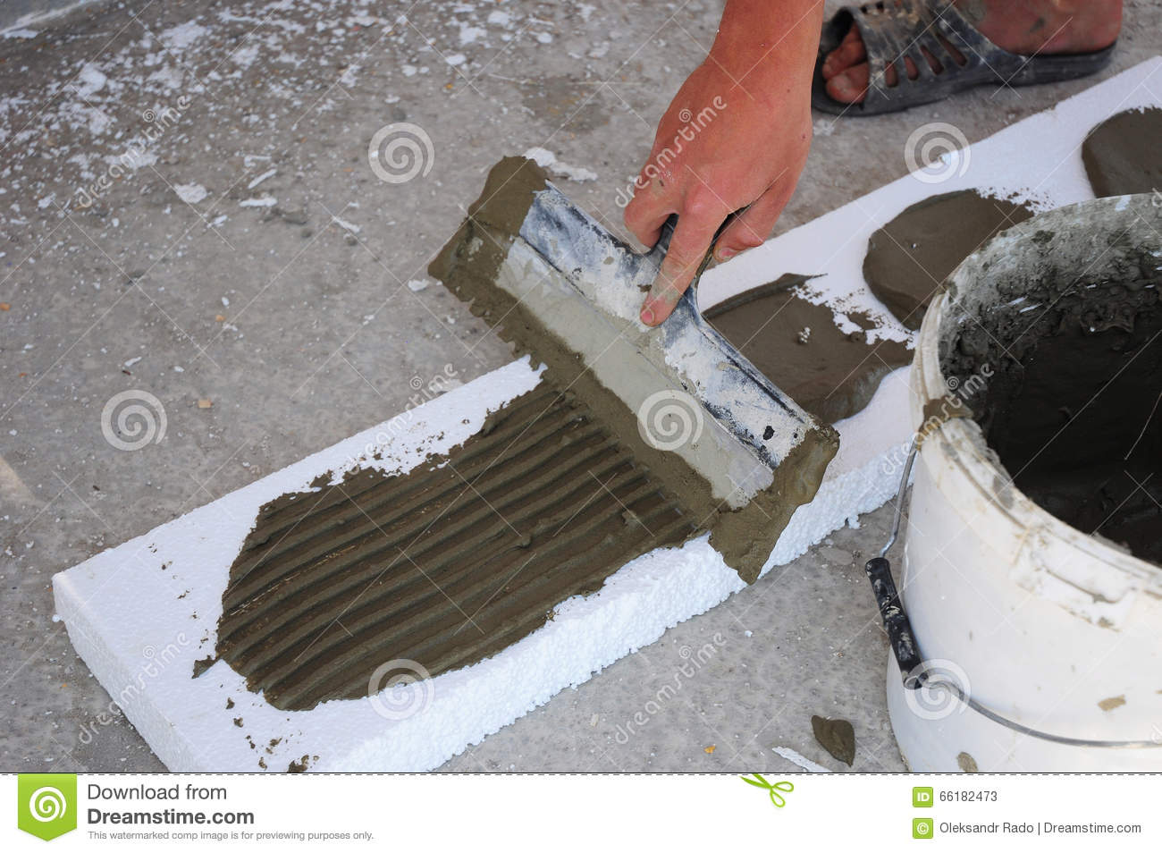 Download Manu0027s Hand Plastering A Wall Styrofoam Or Foam Board Insulation With Trowel. Styrofoam Insulation & Manu0027s Hand Plastering A Wall Styrofoam Or Foam Board Insulation With ...