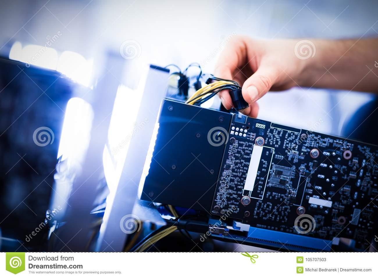 Man`s hand plugging a wire in an input.