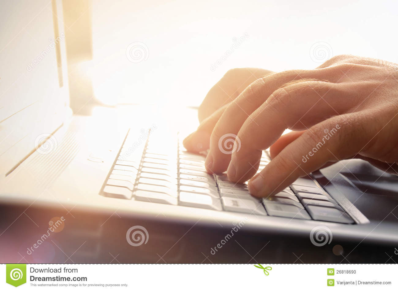 Mans hands typing on laptop keyboard