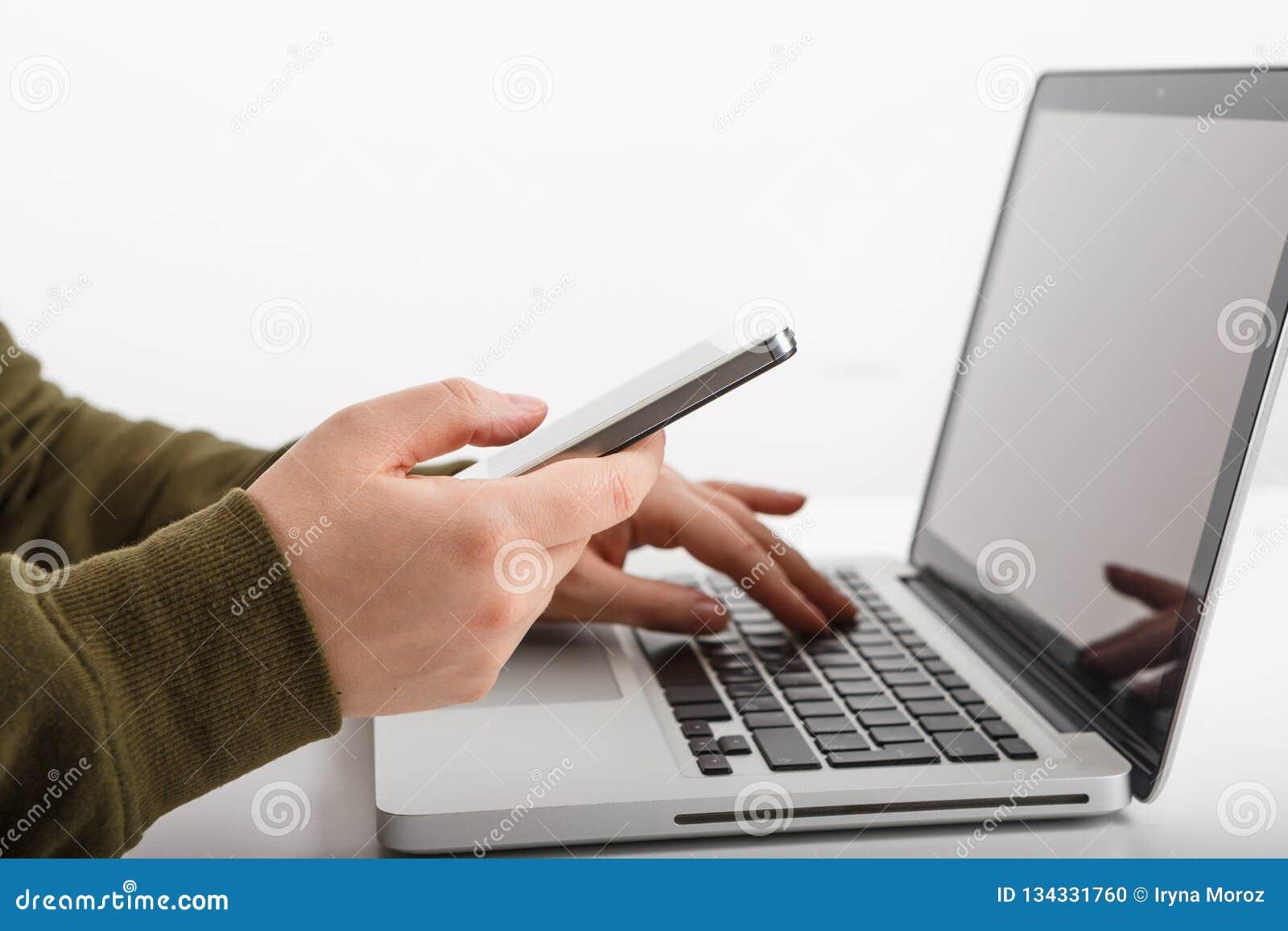 Man& x27;s hands using smartphone in interior