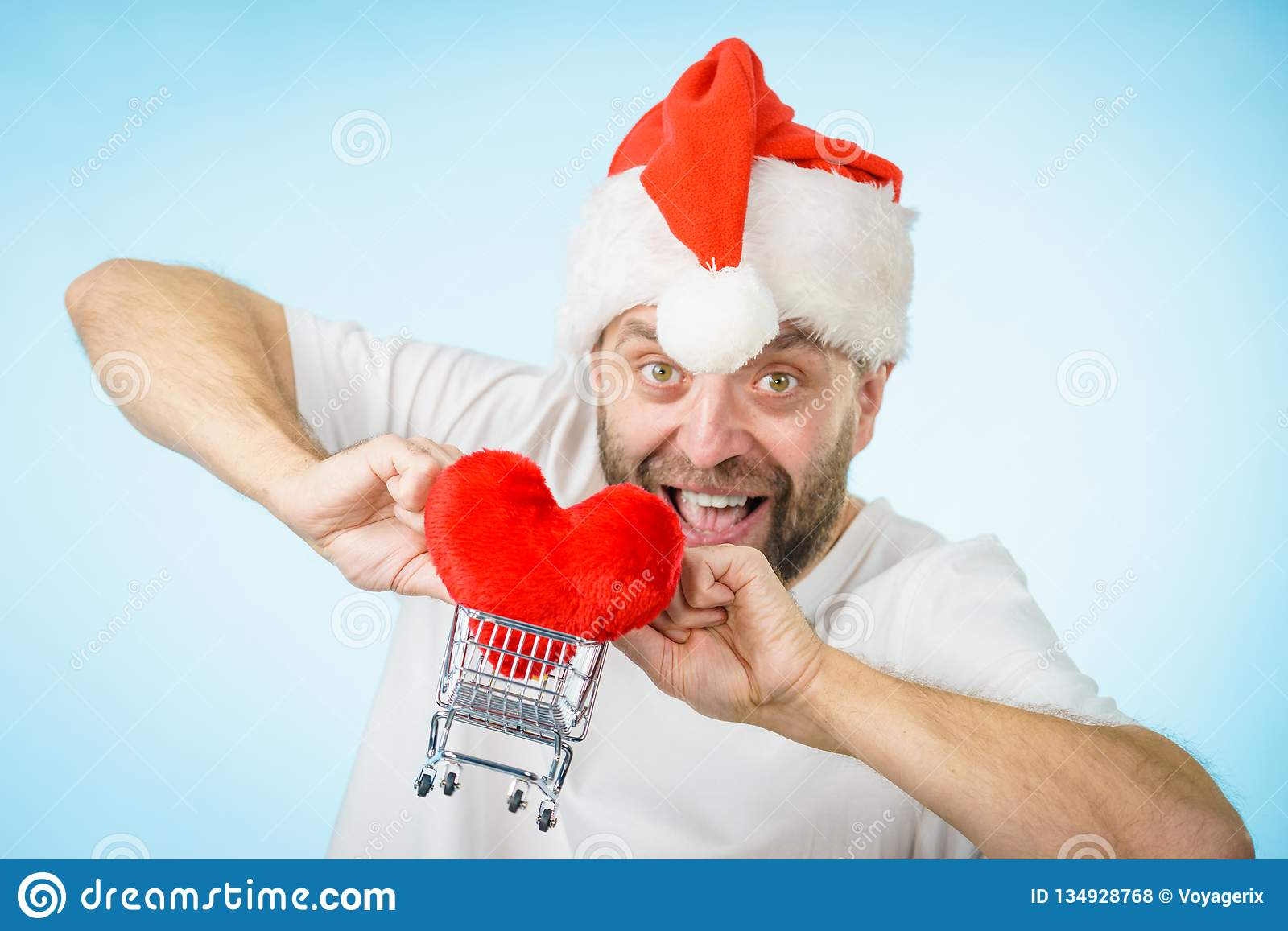 Man In Santa Hat Holds Shopping Cart With Heart Stock Photo - Image ... b51c8277319